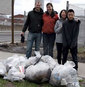 GreeningUSA Green Team members standing behind the bags of trash they picked up during the 2013 OCRRA Earth Day Cleanup.